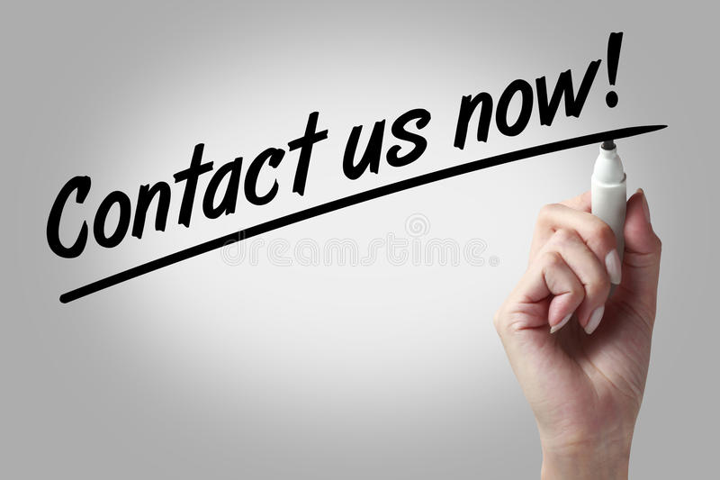 Contact us now. Hand writing Contact Us Now with black marker royalty free stock photo