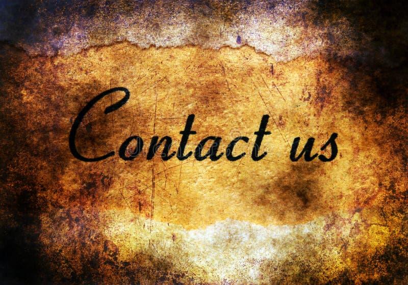 Contactez-nous texte sur le fond grunge photographie stock