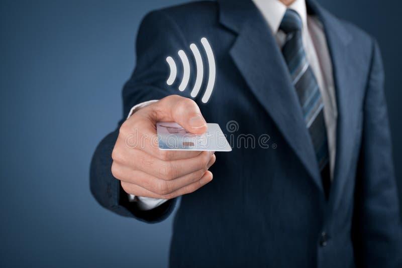 Contactless payment. Concept. Man pay with contactless credit card, virtual contactless symbol above card stock photos