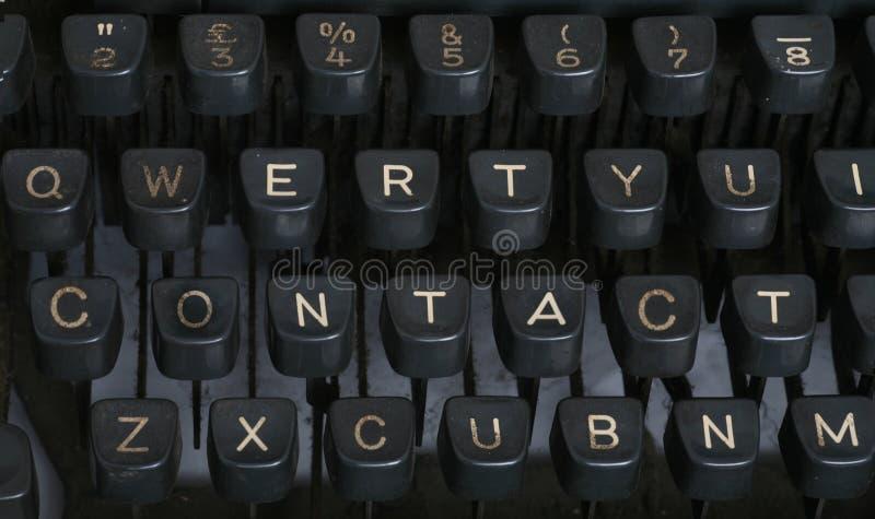 Contacto - máquina de escribir imágenes de archivo libres de regalías