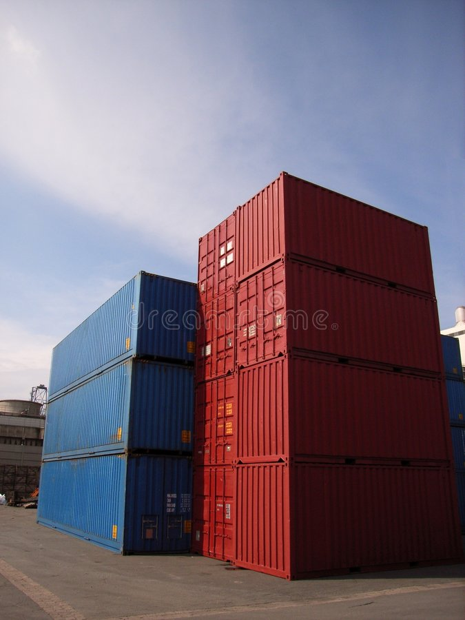 Container. A couple of containers stacked in a port stock image