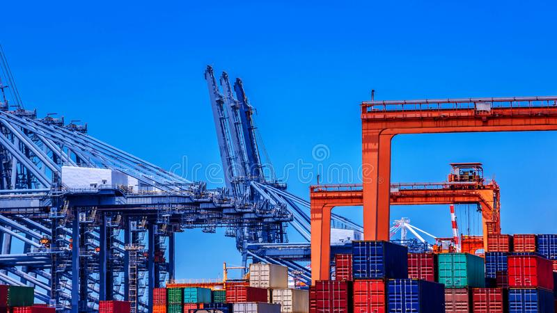Container cargo freight ship in container terminal royalty free stock images