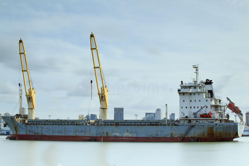 Download Container Cargo Freight Ship With Working Crane Stock Photo - Image: 25621118