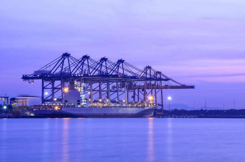 Container Cargo freight ship with working crane bridge stock photography