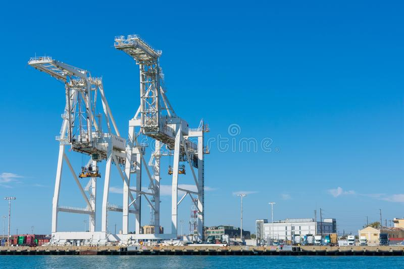 Container cargo gantry Super-Post Panamax cranes lined up at empty dock royalty free stock image
