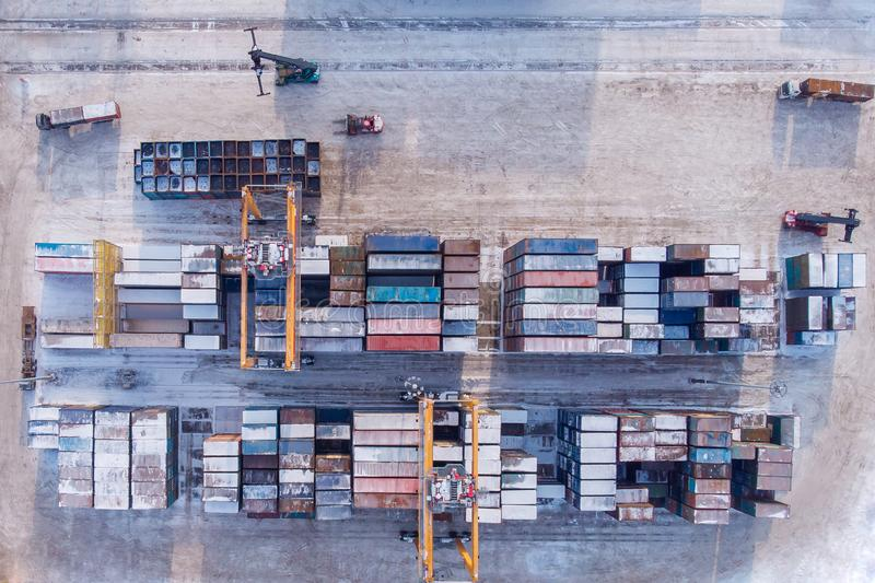 Container cargo ship loading North Arctic port. Concept freight transportation import export and business logistic. Aerial view winter royalty free stock images