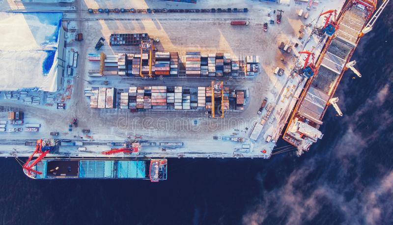 Container cargo ship loading North Arctic port. Concept freight transportation import export and business logistic. Aerial view winter stock image