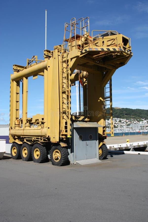 Container crane. In Wellington harbor, New Zealand. Heavy lift cargo machinery. Industrial equipment stock image