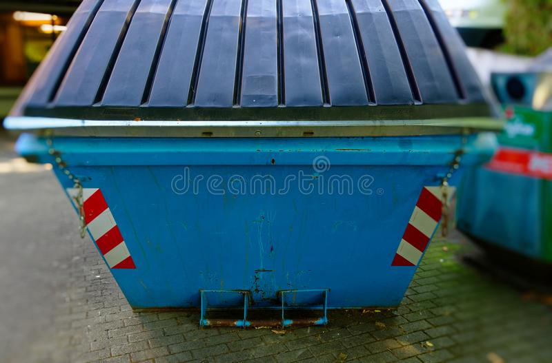 Container from Germany with instructions such as the Container must be filled to clarify the recycling of raw materials.  royalty free stock photo