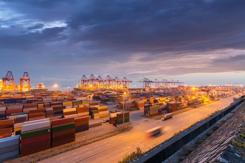 Container port in nightfall stock photography