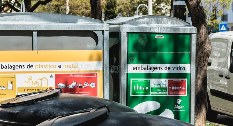 Container of public garbage for recycling in the city center of Quarteira, Portugal. Quarteira, Portugal - May 1, 2018: Container of public garbage for recycling stock photo
