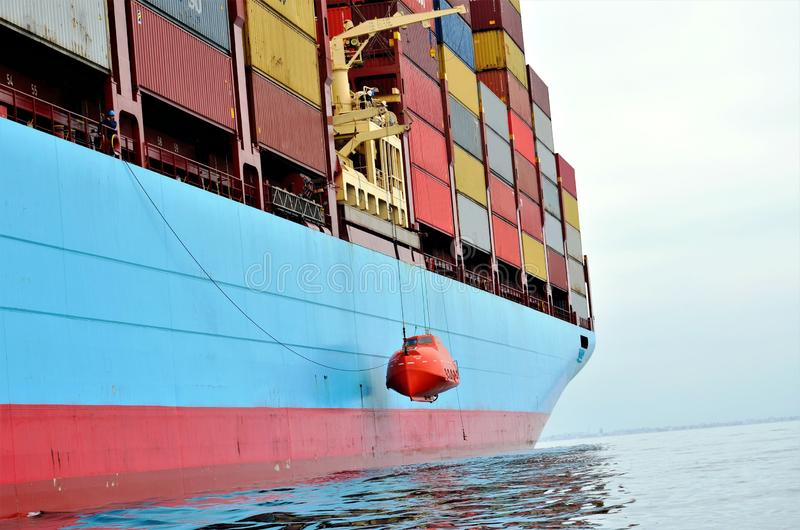 Container ship at anchor, waiting to enter port. stock images