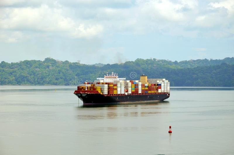 Container ship transiting Panama Canal. Container ship anchored on the Gatun Lake during her Panama Canal transit royalty free stock photography