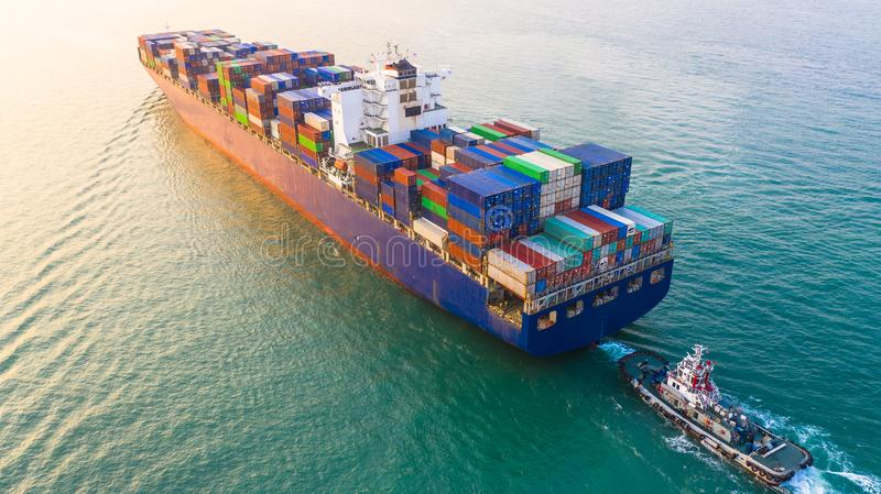 Container ship arriving in port, container ship and tug boat going to sea port, logistic business import export shipping and. Transportation, Aerial view stock photo