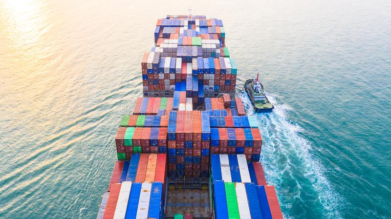 Container ship arriving in port, container ship and tug boat going to sea port, logistic business import export shipping and. Transportation, Aerial view stock photography