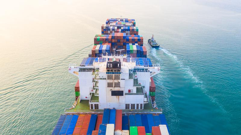 Container ship arriving in port, container ship and tug boat going to sea port, logistic business import export shipping and. Transportation, Aerial view stock images