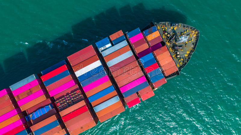 Container ship arriving in port, container ship going to deep sea port, logistic business import export shipping and. Transportation, Aerial view royalty free stock images