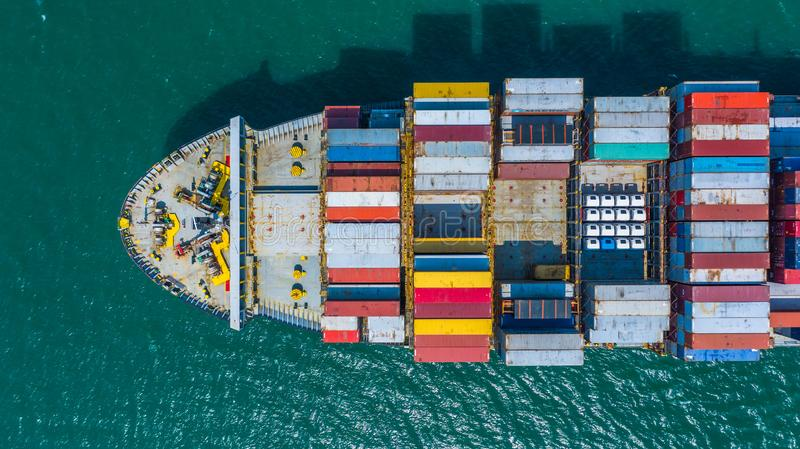 Container ship arriving in port, container ship going to deep sea port, logistic business import export shipping and. Transportation, Aerial view stock photo