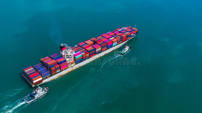 Container ship arriving in port, container ship and tug boat going to deep sea port, logistic business import export shipping and. Transportation, Aerial view stock images