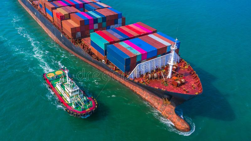 Container ship arriving in port, Tug boat and container ship going to deep sea port, logistic business import export shipping and. Transportation, Aerial view stock photography