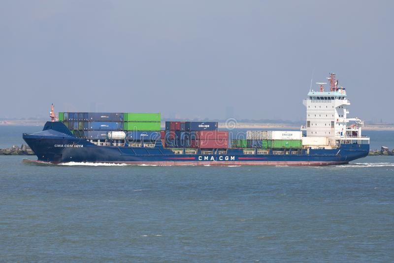 Container ship CMA CGM GOYA outbound Rotterdam. CMA CGM S.A. is a French container transportation and shipping company royalty free stock photos