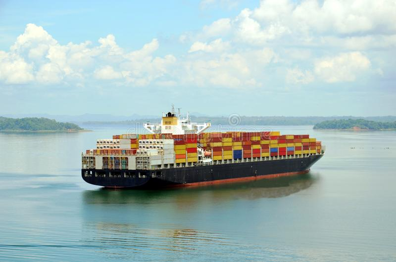 Container ship transiting Panama Canal. Container ship on the Gatun Lake during her Panama Canal transit stock photos