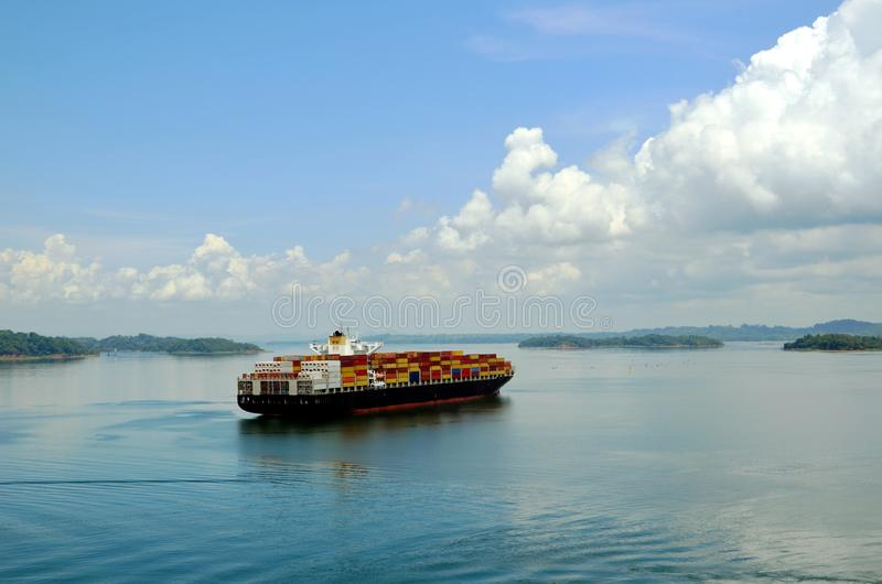 Container ship transiting Panama Canal. Container ship on the Gatun Lake during her Panama Canal transit stock photo