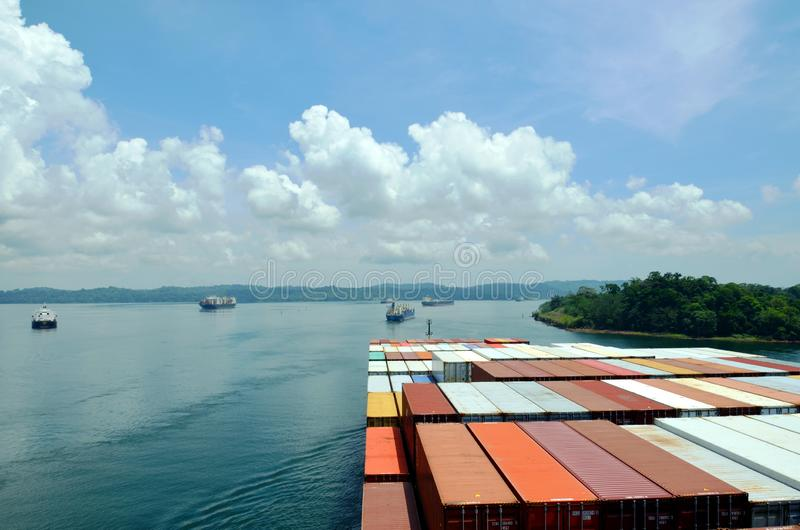 Container ship transiting Panama Canal. Container ship on the Gatun Lake during her Panama Canal transit royalty free stock photos