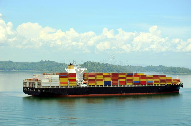 Container ship transiting Panama Canal. Container ship on the Gatun Lake during her Panama Canal transit royalty free stock photo