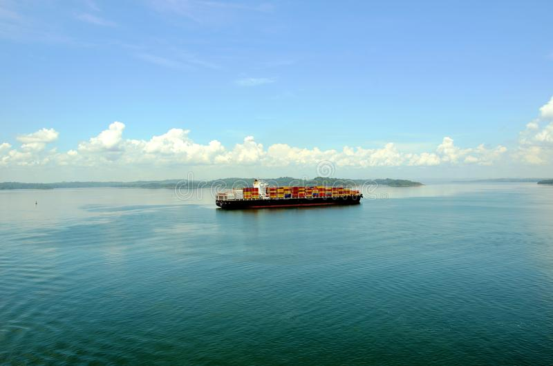 Container ship transiting Panama Canal. Container ship on the Gatun Lake during her Panama Canal transit royalty free stock image