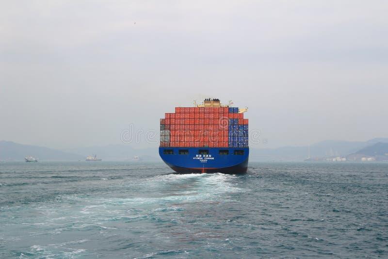 Container ship at Hong Kong harbor stock photos