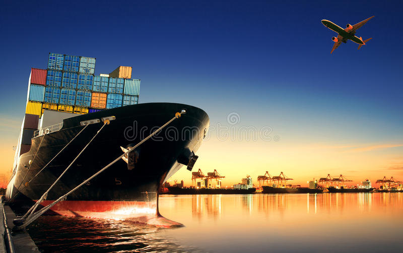 Container ship in import, export port against beautiful morning l royalty free stock photography
