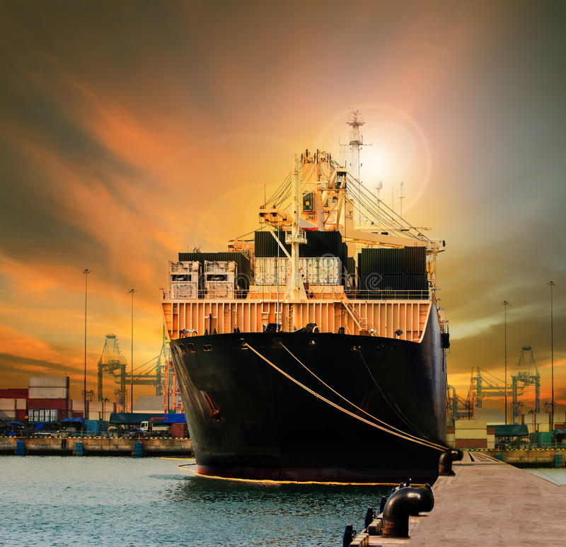 Container ship in import export ship yard use for comercial freight, cargo and logistic industry business royalty free stock photo