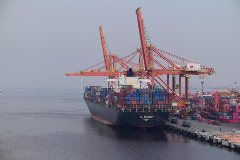 Container ship in the port royalty free stock photo