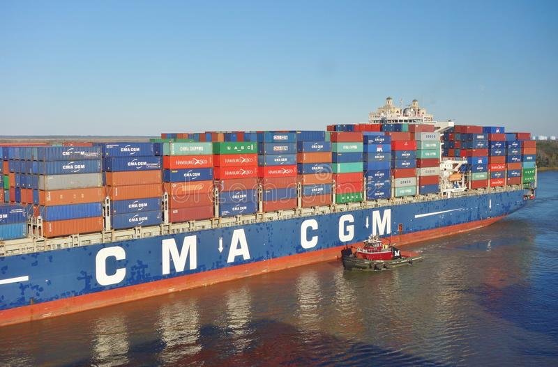 Cargo Container Ships Lined Up To Enter The Port Of