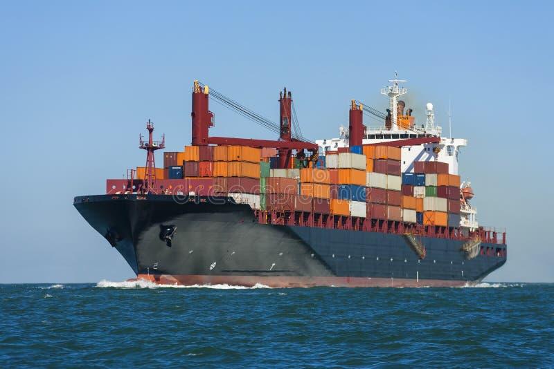 Container Ship at Sea. Container ship or boat sailing at sea stock image