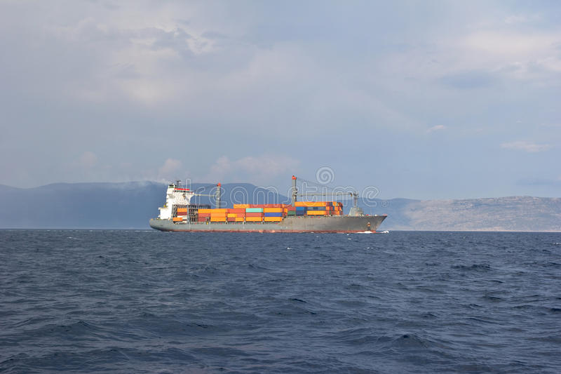 Container ship. Siling adriatic sea royalty free stock photo
