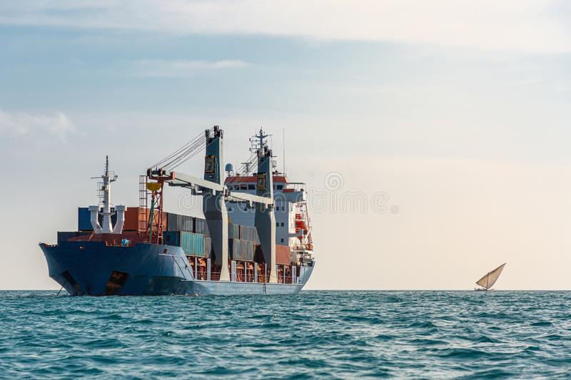 Container ship and small boat royalty free stock images
