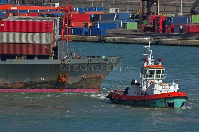Container ship and tag boat royalty free stock photography