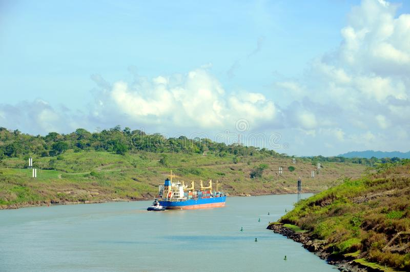 Container ship transiting through Panama Canal. Container ship transiting through Panama Canal on a sunny day royalty free stock image