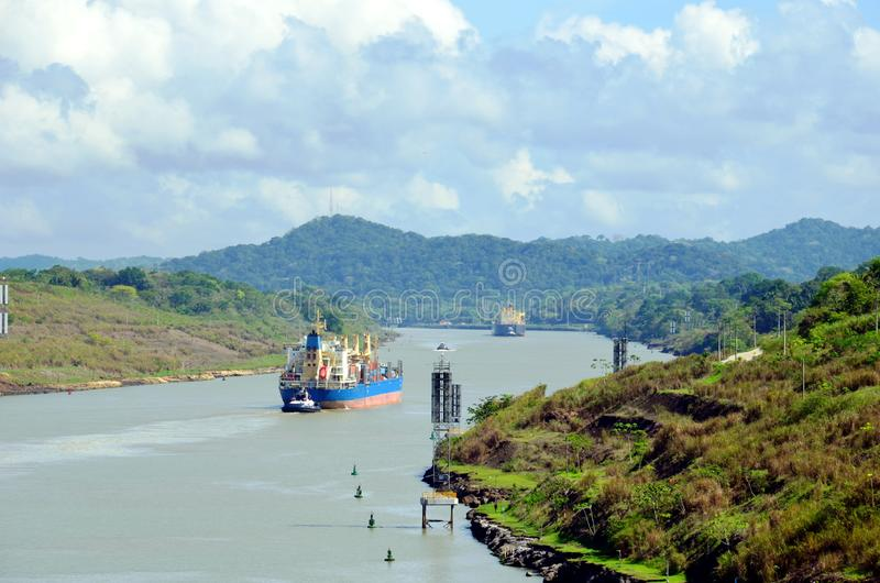 Container ship transiting through Panama Canal. Container ship transiting through Panama Canal on a sunny day stock images