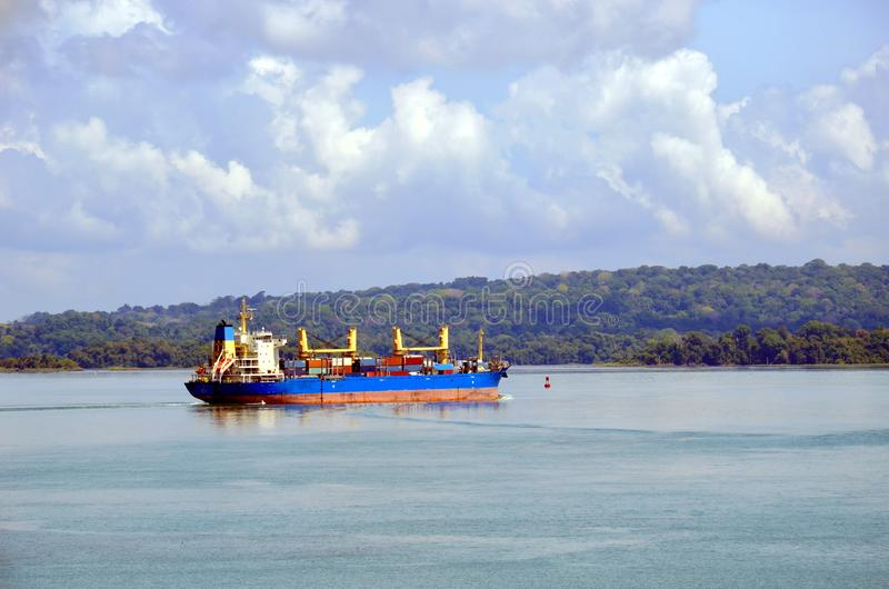 Container ship transiting through Panama Canal. Container ship transiting through Panama Canal on a sunny day, beautiful day stock photos