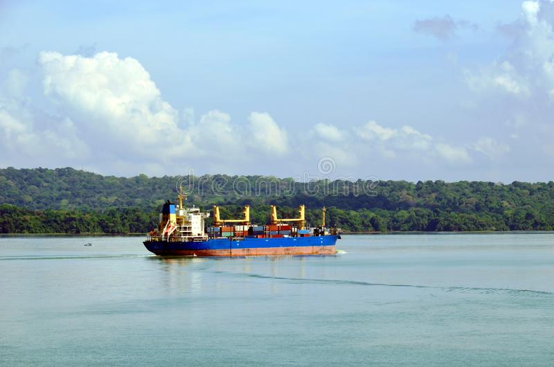 Container ship transiting through Panama Canal. Container ship transiting through Panama Canal on a sunny day, beautiful day stock photo