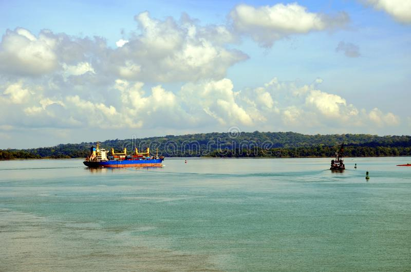 Container ship transiting through Panama Canal. Container ship transiting through Panama Canal on a sunny day, beautiful day, view on the Gatun Lake royalty free stock photo