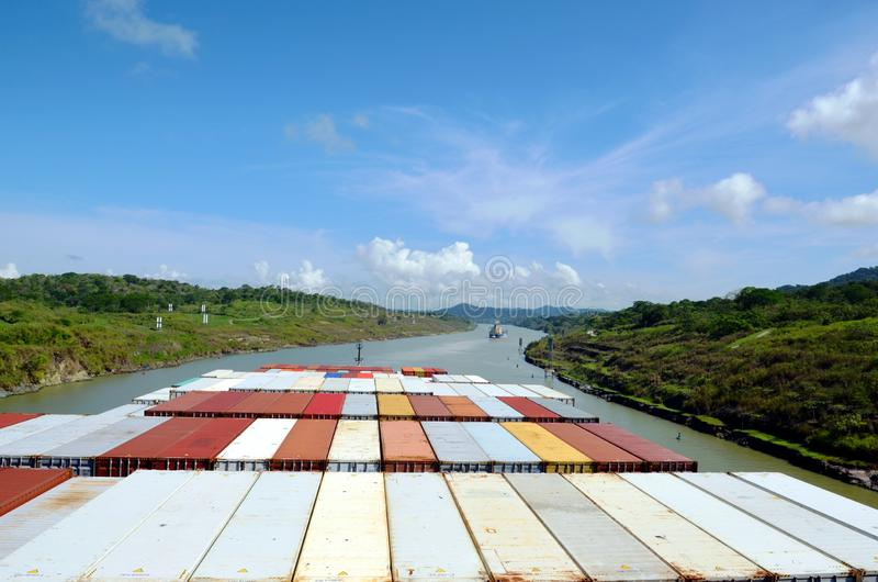 Container ship transiting through Panama Canal. Container ship transiting through Panama Canal on a sunny day, view from the navigation bridge stock photos