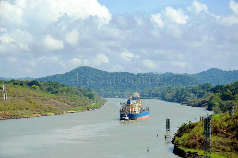 Container ship transiting through Panama Canal. Container ship transiting through Panama Canal on a sunny day stock photo