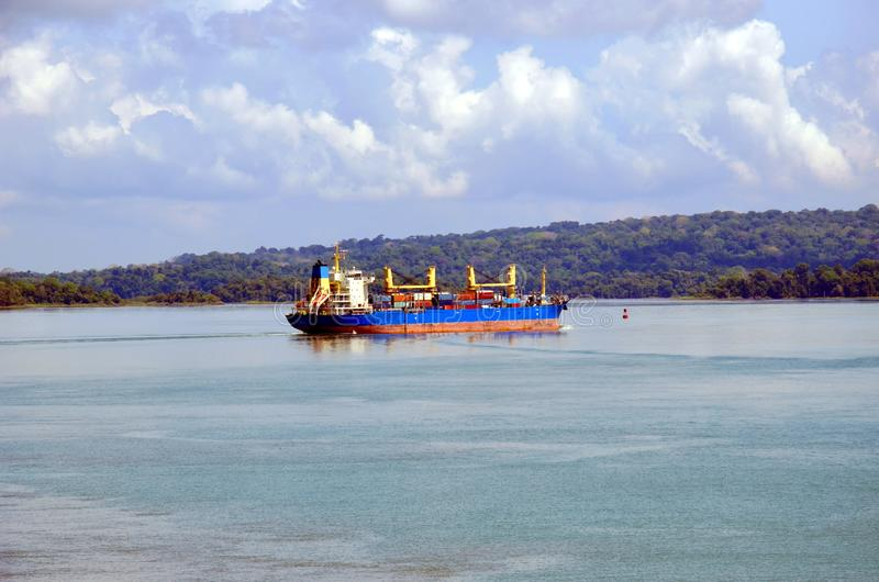 Container ship transiting through Panama Canal. Container ship transiting through Panama Canal on a sunny day, beautiful day royalty free stock images