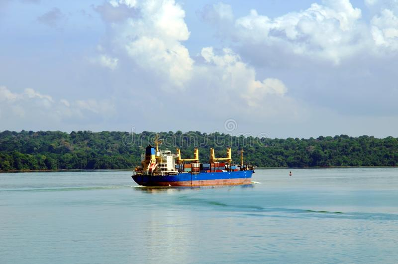 Container ship transiting through Panama Canal. Container ship transiting through Panama Canal on a sunny day, beautiful day stock images