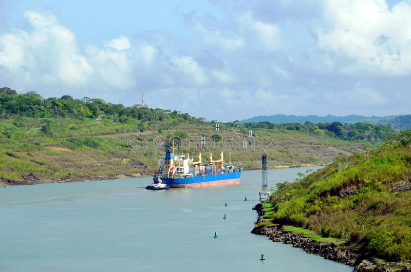 Container ship transiting through Panama Canal. Container ship transiting through Panama Canal on a sunny day royalty free stock photography