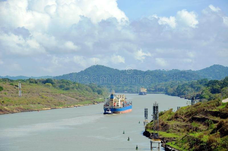 Container ship transiting through Panama Canal. Container ship transiting through Panama Canal on a sunny day royalty free stock photo
